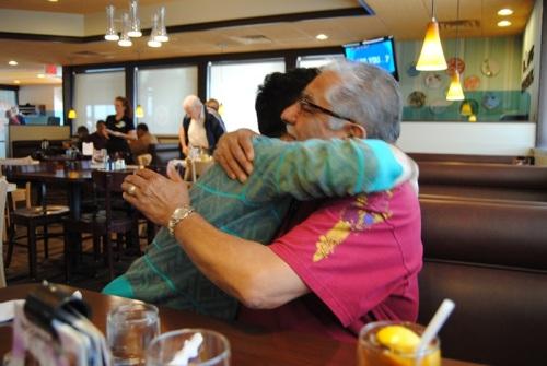 John's first hug.