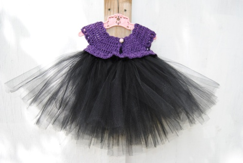 I found this lovely purple yarn from Hobby Lobby called Mimosa. It is a combination of cotton and rayon. I loved the way the purple had black running through it. And it screamed at me to be another tutu dress. So I added black tulle to the bottom and I do love how it turned out.