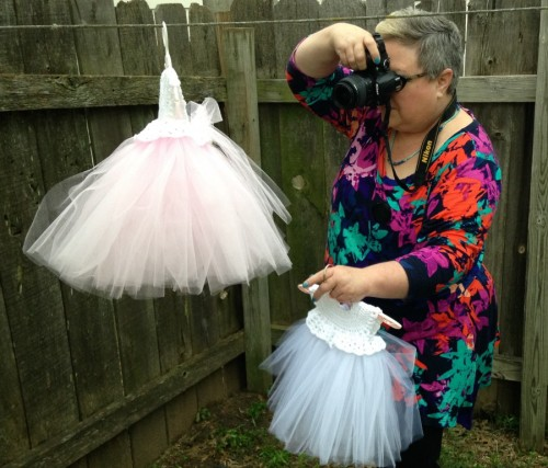 Take pictures of me taking pictures of the tutus. I was having such a hard time because the wind had picked up and one of my hangers did not have the little swivel handle, so I used the clothesline. It was also starting to rain. Oh well...I always try to go the extra mile for just the right photo. So what are you all obsessing over? I hope to have time to share more of my long weekend this weekend. Have a great one, ok?