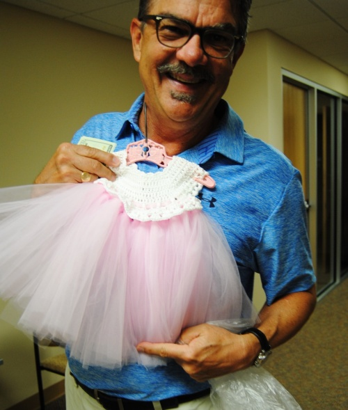 Here's another satisfied new Grandpa. Mark is one of my co-workers who just became a Grandfather for the first time last month. When I showed him the little pink and white tutu he said send me a picture and I will check with my wife. He had hardly sent the photo to his wife with a question of what do you think? Should we buy one? She sent back a YES in all caps. As I have said before I just love seeing these loving Grandfathers buying gifts for their grandbabies.