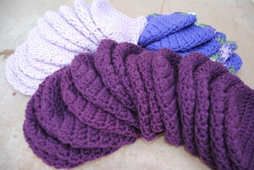 Between the baby booties and the purple hats I have been quite busy. I now have completed 35 purple hats. So what have you all been up to?