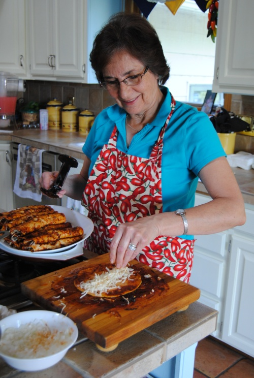 Here's John's sister Andrea finishing up her famous enchiladas.