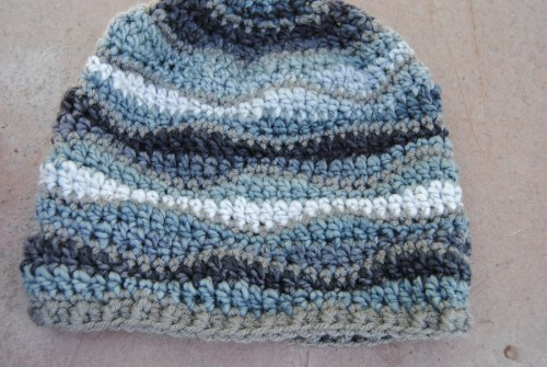 Here is the one that will be on display at Picket Fence. I used Liz McQueen's free pattern called Brain Waves Beanie. You can find it on Ravelry here.