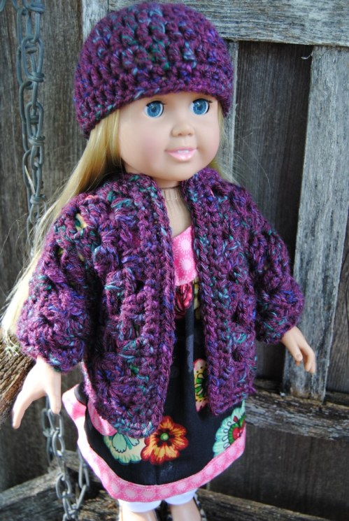 I've been busily working this past weekend on some American Girl doll crochet sweaters,