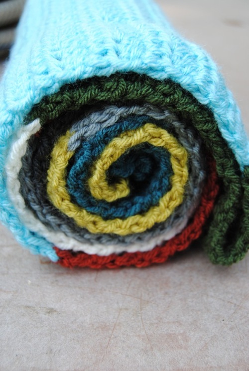 Here we go with the crochet; I made a long infinity scarf and loved how it looked all rolled up. I have a wire shelf that John will be painting for me and I think the scarves will look cool all rolled up on it.