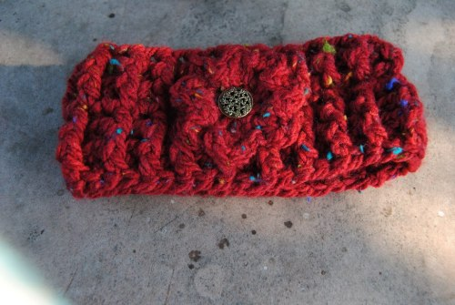Here's a headband that I made with the leftover yarn made from the poncho and since taking this picture I made another 7 headbands of all different colors. I'm waiting to photograph them on my new turning pegboard display case that John is painting for me.