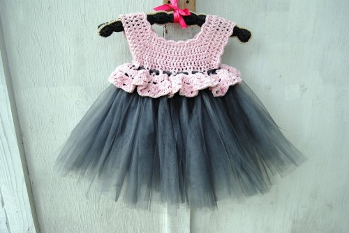 Here's another crocheted yoke tutu. It should fit about a four year old.