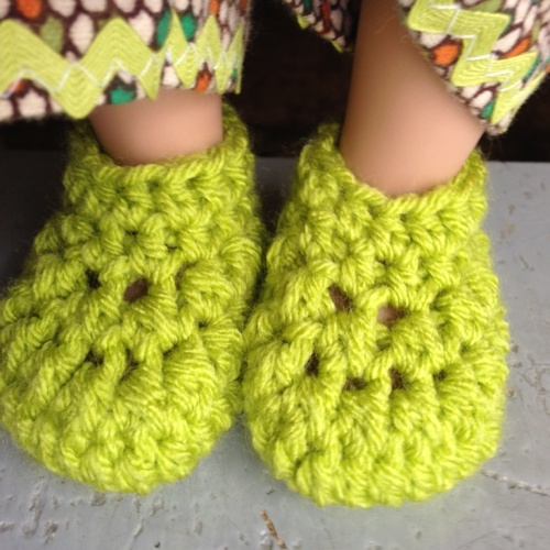 I have to admit the slippers are one of my favorites too and I was so happy with myself since I remembered to write down the pattern as I went. :)