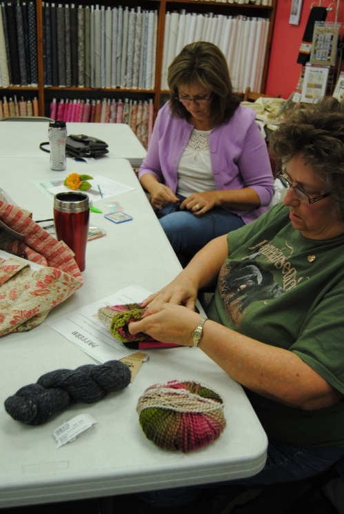 My crocheted boot cuff class went well and I was glad that three people signed up. Here's Suzie and Ruth working hard at sewing their boot cuffs up.
