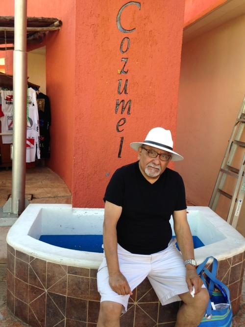 I couldn't resist a photo of John sitting in front of the Cozumel sign.