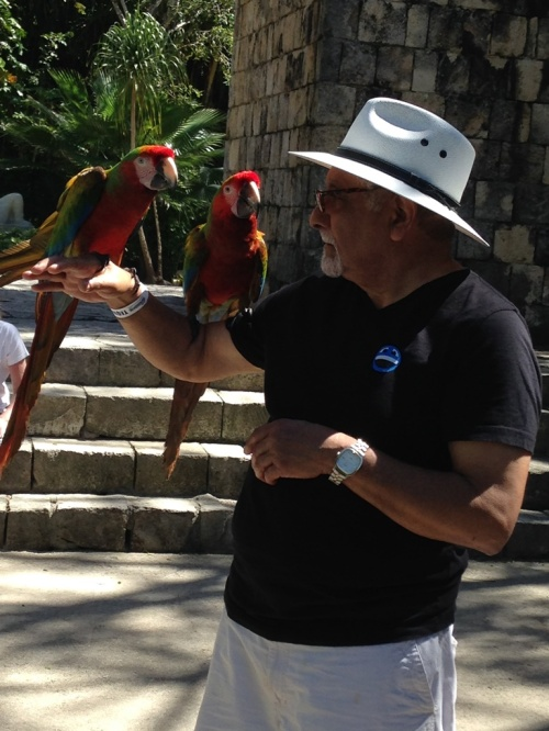 This was such a great photo opportunity. We couldn't resist the young man who owned the parrots.