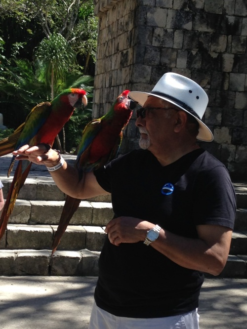 That one parrot wanted to take John's hat off of him.